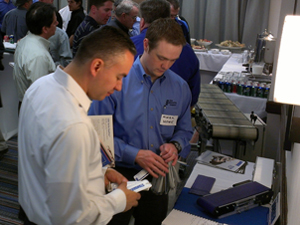 The Knotts Company's Mark Howe shows an attendee what's new from Dorner Conveyors